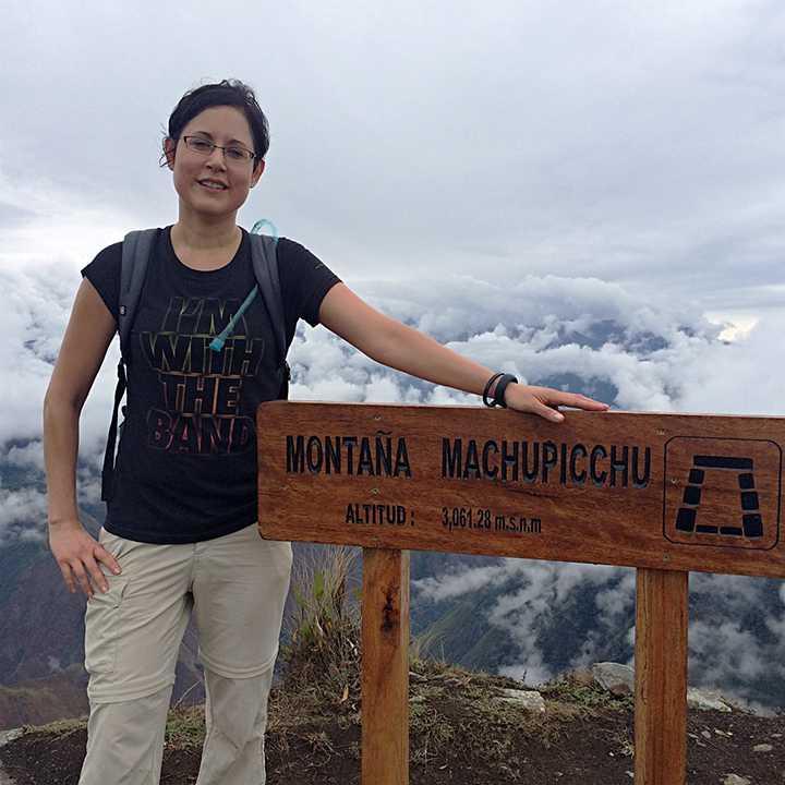 Pamela by the Machu Picchu Mountain Sign